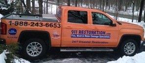 Fire Damage Restoration Truck On The Scene