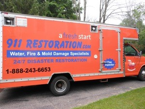 Water Damage Millstone Restoration Box Truck Parked At Residential Job Location