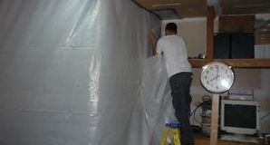 Water and Mold Damage Restoration Tech Using A Vapor Barrier