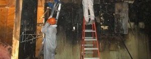 Water Damage and Mold Restoration Technicians Inspecting Water Leaks