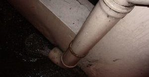 Water Damage From Faulty Downspout That Caused Mold Growth