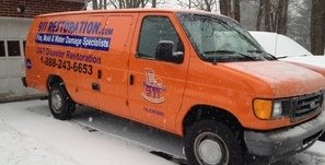 Water and Mold Damage Restoration Van At Winter Residential Job Site